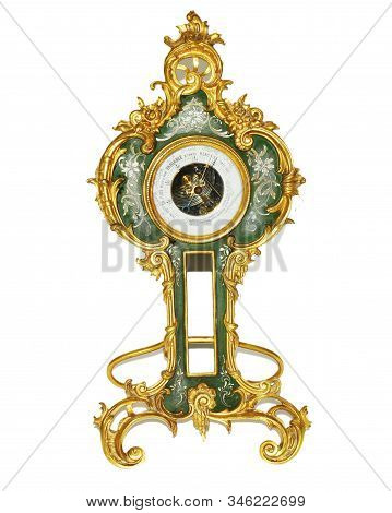 Golden antique table barometer with isolated white background. stock photo