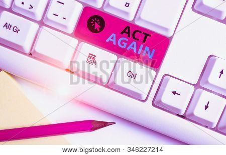 Conceptual hand writing showing Act Again. Business photo text do something for a particular purpose Take action on something White pc keyboard with note paper above the white background. stock photo
