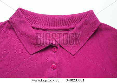 Purple shirt with buttoned up collar neck. Casual soft purple or dark pink color t-shirt isolated on empty white background, stylish casual unisex apparel clothing, simple shirt design stock photo