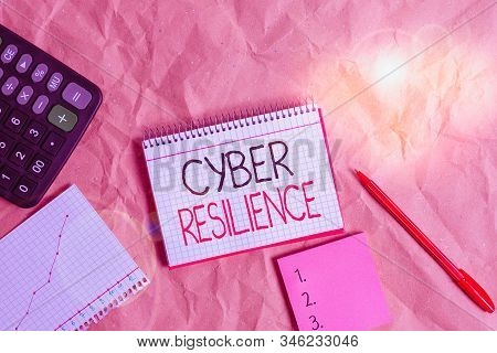 Text sign showing Cyber Resilience. Conceptual photo measure of how well an enterprise can analysisage a cyberattack Papercraft craft paper desk square spiral notebook office study supplies. stock photo