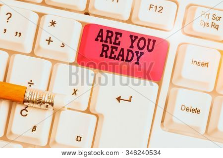 Word writing text Are You Ready. Business concept for Alertness Preparedness Urgency Game Start Hurry Wide awake White pc keyboard with empty note paper above white background key copy space. stock photo