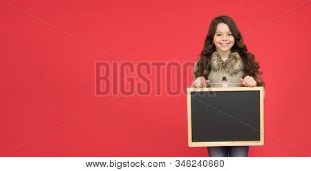 Winter activity advertisement. Time for winter holiday. Useful info. Winter shopping sales. Announcement board. Profitable deal. Happy girl blank blackboard. copy space. Important information. stock photo