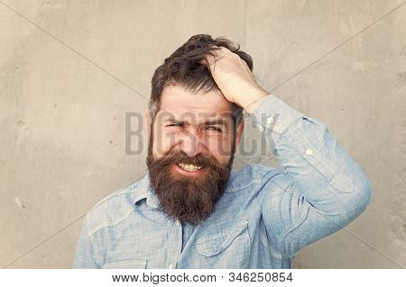 Pain and migraine. Man bearded hipster painful grimace. Painful face expression. Painful experience concept. Frustration and disappointment. Medical cures. Painkillers advertisement. Health and ill. stock photo