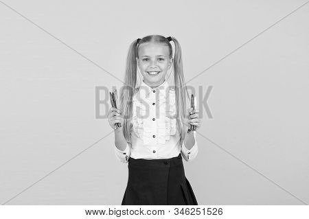 Schoolgirl hold school stationery supplies for crafts. Tutorials for little hands. Favourite part of going back to school. Creative crafts. Develop creativity. Crafts for elementary school kids. stock photo