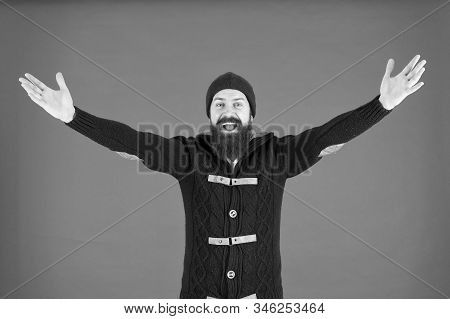 Be happy. get warm and comfortable. hipster mens jacket. happy man autumn style. beard care in winter. male fashion. brutal man knitted hat. knitted hat accessory. bearded man knitwear sweater. stock photo
