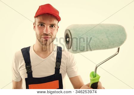 Paint roller close up. Repair service. Repair and renovation concept. Handyman home repair. Repairing and renovating. Home improvement. Man in helmet laborer on white background. Repair workshop. stock photo