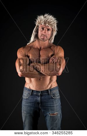 Keep calm and build muscles. Athlete or sportsman. Sexy athlete on black background. Handsome athlete keeping strong arms crossed with biceps triceps. Athlete or bodybuilder with fit torso wear jeans. stock photo