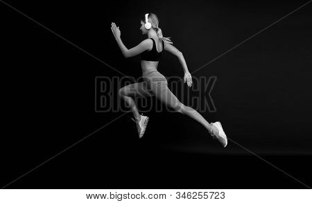 Run hard to get into shape. Woman run black background. Jogger jump with long run. Fit athlete in fashion sportswear. Athletic female sprinter or runner. Active and dynamic. Run fast, finish soon. stock photo