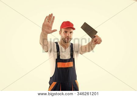 Focused on result. Repair service. Repair and renovation concept. Handyman home repair. Repairing and renovating. Home improvement. Man in helmet laborer on white background. Repair workshop. stock photo