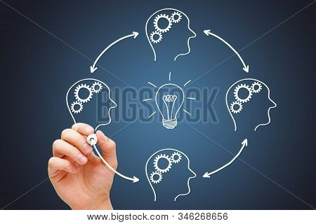Business team working in collaboration on great idea development. Teamwork is the best way to build best ideas. stock photo