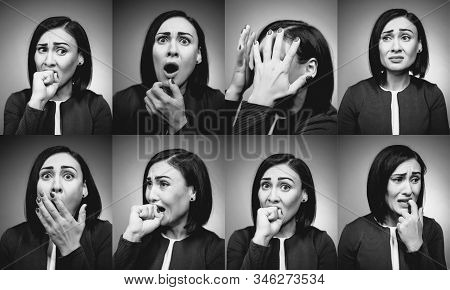 anxious brunette female worry and bite fingers stock photo