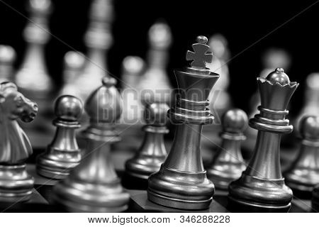 Strategy chess battle Intelligence challenge game on chessboard. Success the chess strategy concept. Chess business leader and success idea. Chess strategy game business competition success play. Chess set photographed on a chess board. stock photo