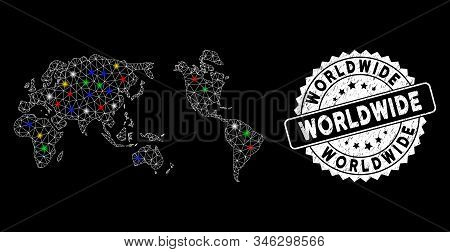 Bright mesh worldwide map with lightspot effect, and seal. Wire carcass triangular worldwide map mesh in vector format on a black background. White round seal stamp with grunged texture. stock photo