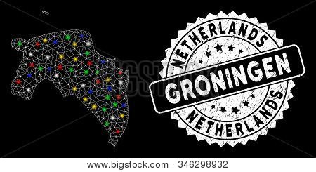 Bright mesh Groningen Province map with lightspot effect, and seal stamp. Wire carcass triangular Groningen Province map network in vector format on a black background. stock photo