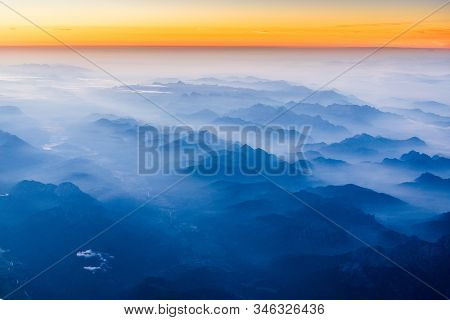 Sunrise above Alps, aerial view of Austria mountains stock photo