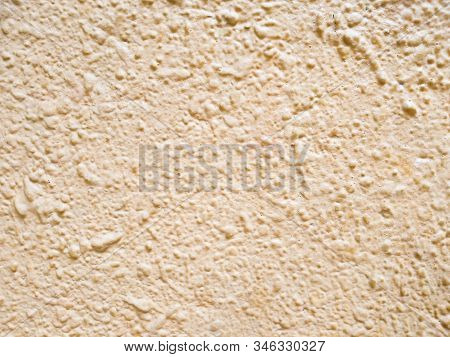 Abstract pink background texture concrete wall . the pink texture of the surface of the wall covered with decorative plaster of the woodworm type, close-up architecture abstract background stock photo