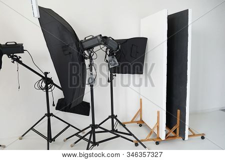 Main photography tools. Professional photography equipment rests inside workroom waiting to be used. stock photo