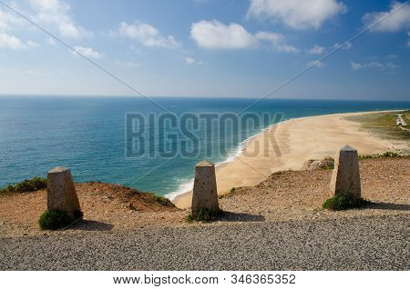 Portugal, Nazare in summer, coastline landscape of the Atlantic ocean in summer, clean wide beaches with white sands of Nazare, azure blue water of the Atlantica, cliff road bumpers in Nazare stock photo