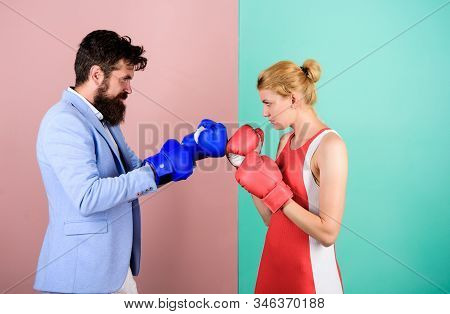 Man and woman boxing fight. Family life. Complicated relationships. Couple romantic relationships. Boxers fighting gloves. Difficult relationships. Couple in love competing boxing. Conflict concept stock photo