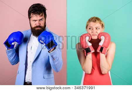 Family life. Complicated relationships. Couple romantic relationships. Boxers fighting gloves. Difficult relationships. Couple in love competing boxing. Conflict concept. Man and woman boxing fight stock photo