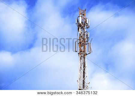 Antenna of the telecommunications tower. Communication network. Technology at the top of GSM telecommunications. Masts for mobile phone signal. Tower with cellular antennas on a blue sky background stock photo