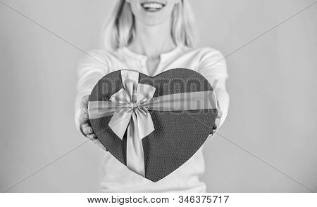 Romantic surprise gift for him. Female hands hold gift box. Prepared something special for him. She romantic person. Valentines gift for boyfriend. Find special gift for boyfriend fiance or husband stock photo