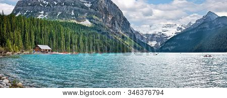 The beautiful turquoise glacial Lake Louise in Banff National Park. One of the most famous Canadian lakes stock photo