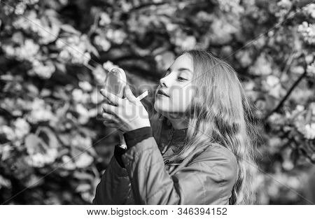 Girl In Cherry Flower. Kid With Lipstick Makeup. Small Girl Child In Spring Flower Bloom. Smell Of T