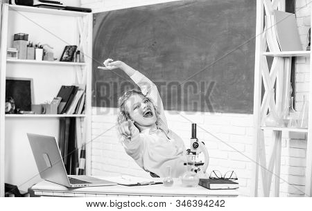 Teacher adorable woman try to relax in classroom. Just relax. Find way to relax at workplace. School pedagogue occupation. Mental health and relaxation methods. Stretching after hard working day stock photo