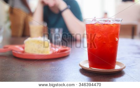 Selective Focused Thai Tea, Refreshing Soft Drink to get rid of thirst with sweet aroma from lime and cooling tasty flavor. Colorful Traditional Asian Drink for Hot Thirsty Tropical Summer concept. stock photo