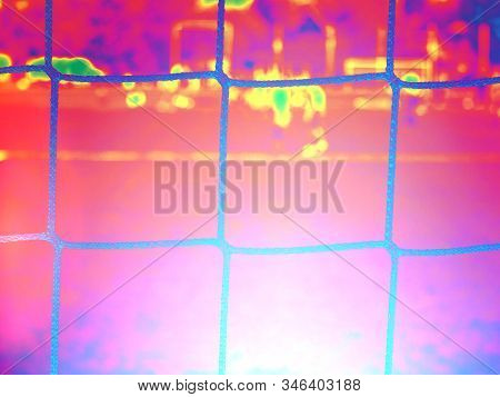 Soccer gate net on sunset sky background.  Abstract filter. stock photo