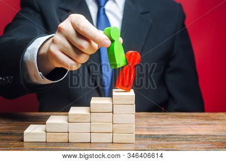 Businessman is replacing an employee with a new one on career ladder. Head Offset. Business optimization. Fight corruption. System recovery. Strengthening change of power, capture control of business. stock photo
