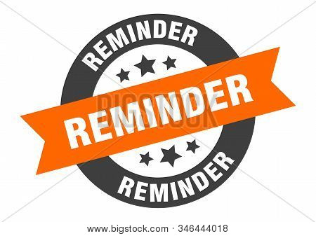reminder sign. reminder orange-black round ribbon sticker stock photo