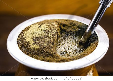 Chimarrão, or mate, is a beverage characterized by South American culture. Typical Brazilian drink, served hot and frothing. Tasty traditional drink from Rio Grande do Sul state. Gaucho symbol. stock photo