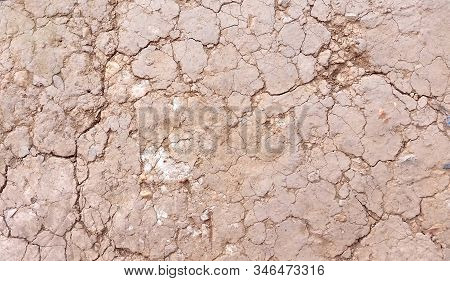 Cracked ground or close-up dried  ground. Images of ground texture. Hard shadows and  damaged  ground from top view. Royalty free stock picture. stock photo