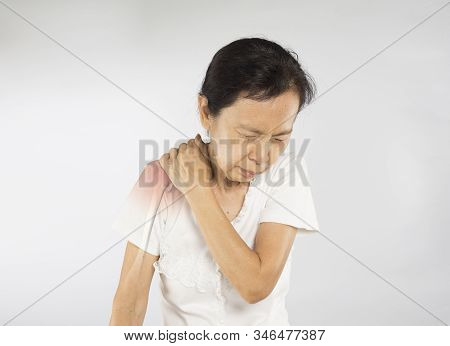 old asian woman feel shoulder bone injury stock photo