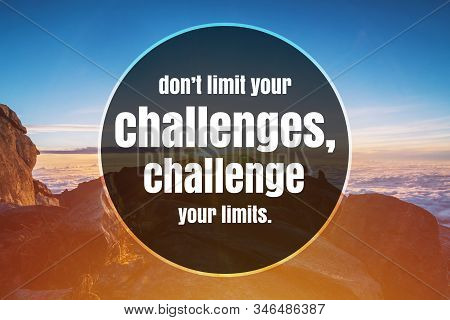 Inspirational and Motivational Quote. Don't Limit Your Challenges, Challenge Your Limits. Mountain Top Background. stock photo