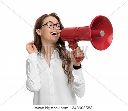 Young woman with megaphone on white background stock photo