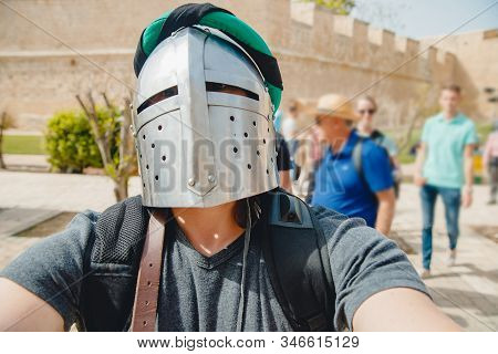 Selfie photo of man wearing knight helmet with armor Viking festival, Malta stock photo