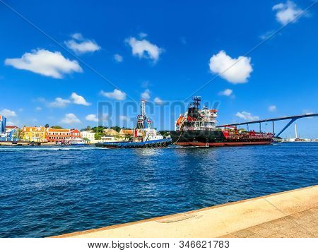 Queen Juliana Bridge Over Curacao. The Island Curacao is a tropical paradise in the Antilles in the Caribbean sea with beautiful architecture, beaches. stock photo