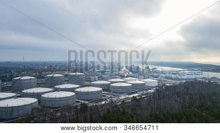 Aerial View White Oil Tank, Storage Of Oil And Petrochemical Products Ready For Logistic And Transpo