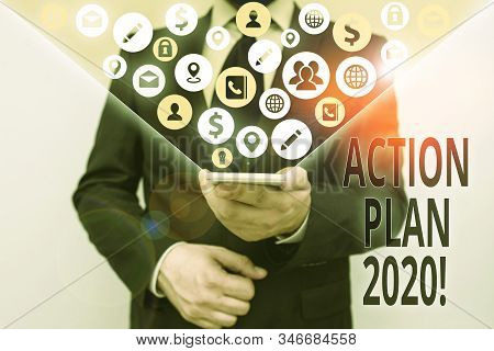 Conceptual hand writing showing Action Plan 2020. Business photo text proposed strategy or course of actions for current year. stock photo