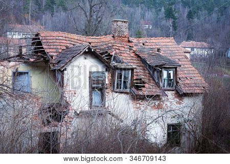 Old house home decor for renovation. Rustic abandoned house for renovation. Abandoned old house. Rustic house for home decor. Ruined old house. Old vintage house home decor. Old rustic house exterior. stock photo