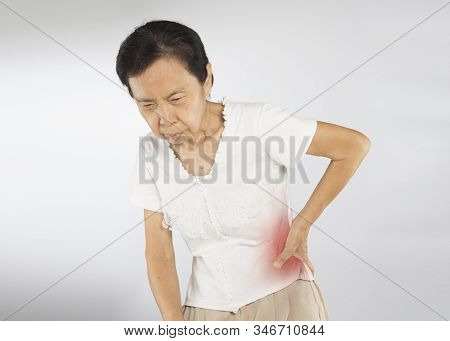 old asian woman feel spine muscle pain stock photo