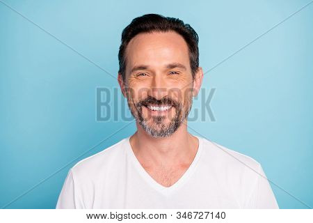 Close-up portrait of his he nice attractive content cheerful cheery glad brunette guy qualified IT geek expert isolated over bright vivid shine vibrant teal green blue turquoise color background stock photo