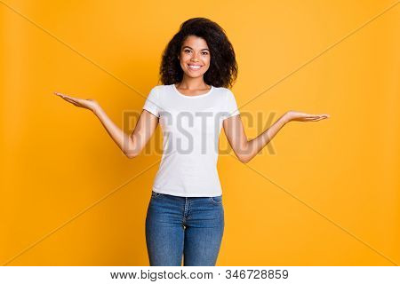 Photo of cheerful positive nice pretty cute girlfriend in jeans denim white t-shirt holding two objects on hands smiling toothily showing isolated vivid color background stock photo