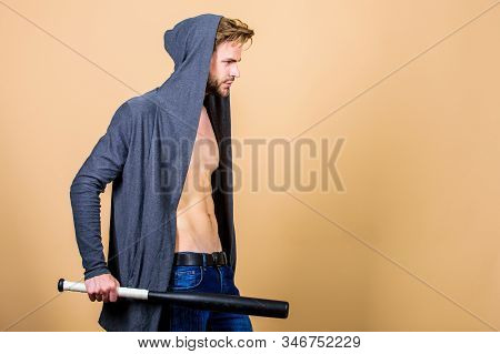 aggression and anger. sport activity. full of energy. Sport. Hooligan macho hits the bat. Bandit gang and conflict. man with baseball bat. Sexy muscular man fighting. Full concentration stock photo