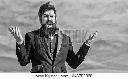 Bearded man touch beard. Man with beard outdoor. brutal caucasian hipster with moustache. Mature hipster with beard. Future success. Male formal fashion. Bearded man. Businessman against the sky stock photo