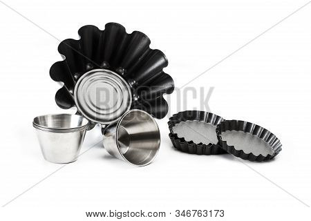 A set of baking molds on a white background stock photo