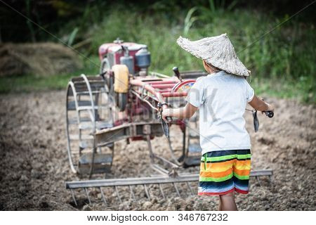 Child labor, Poor children driving a plow farming area, Children have to work because of poverty, World Day Against Child Labour concept. stock photo